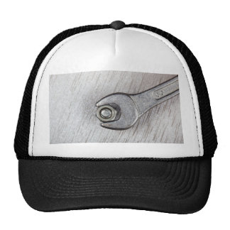 Wrench, bolt and nut on metal surface trucker hat