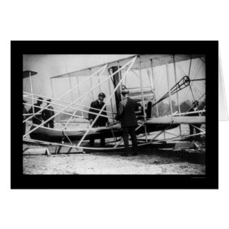 Wright Examines Canoe Attachment to Airplane 1909 Card