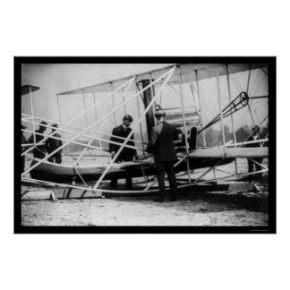 Wright Examines Canoe Attachment to Airplane 1909 Poster