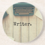 """Writer writing desk retro typewriter sandstone coaster<br><div class=""""desc"""">writer For your favorite author or writer Image of a wood writing desk with a vintage typewriter and notebooks. Use the template to personalize with your own message in typewriter font.</div>"""