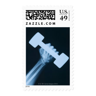 X-ray image of human hand with weight, close-up postage stamps
