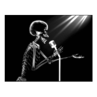 X-RAY SKELETON SINGING ON RETRO MIC - B&W POSTCARD