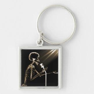 X-RAY SKELETON SINGING ON RETRO MIC - SEPIA KEY CHAINS