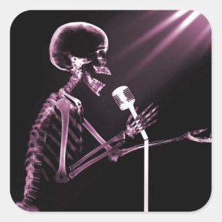 X-RAY VISION SKELETON SINGING ON RETRO MIC - PINK SQUARE STICKER