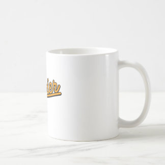 Xavier in orange coffee mug