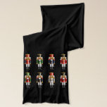 "Xmas Nutcrackers Scarf<br><div class=""desc"">This cute scarf,  perfect to keep you warm during the holiday season,  featuring a small army of colorful nutcracker toy soldiers in uniforms inspired by the popular children&#39;s ballet &quot;The Nutcracker&quot; makes a wonderful Christmas gift for family and friends.</div>"