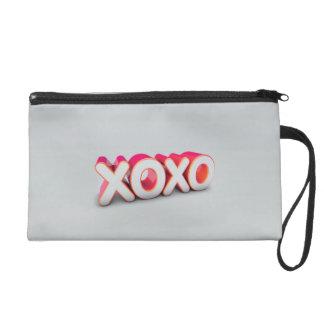 XOXO WRISTLET CLUTCHES