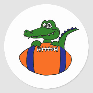 XX- Awesome Gator on a Football Cartoon Classic Round Sticker