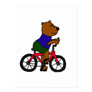 XX dibujo animado que monta en bicicleta del oso Postal