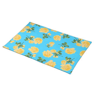 Yello roses floral pattern on blue cloth placemat