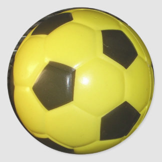 Yellow and black Football. Classic Round Sticker