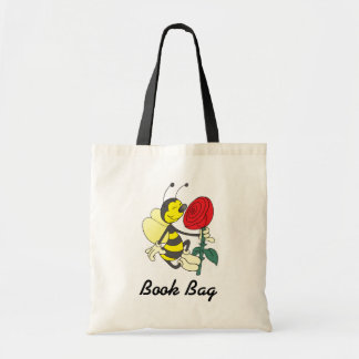 yellow and black hornet wasp bee with a red rose tote bag