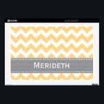 "Yellow and Gray Chevron 17 Inch Laptop Skin<br><div class=""desc"">This custom sunshine yellow and gray chevron laptop skin can be personalized with your name on the grey PRINTED stitched ribbon look design. This fits both a 17 in Mac or PC laptop. Accessorize your favorite gadget with a modern zigzag striped skin. Designed by Chrissy H. Studios, LLC. All Rights...</div>"