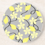 "Yellow and Gray Flowers. Floral Pattern. Drink Coaster<br><div class=""desc"">Flower pattern. Floral design in sunny shades of yellow. Small light yellow flowers,  with bright sunny yellow leaves and a gray background.</div>"