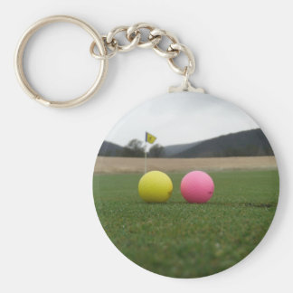 yellow and pink golf balls, key chain