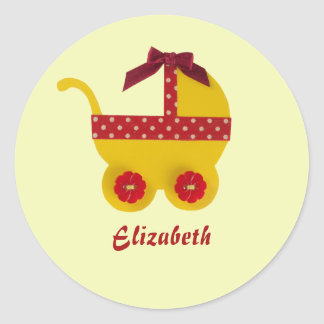 Yellow and red baby carriage for baby girl shower classic round sticker