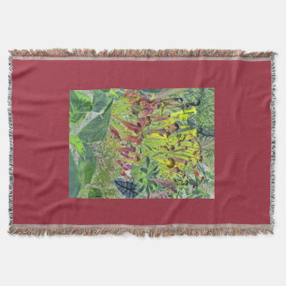 Yellow and red pitcher plants on red throw