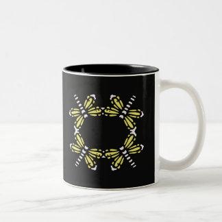 Yellow and white dragonflies on black mug