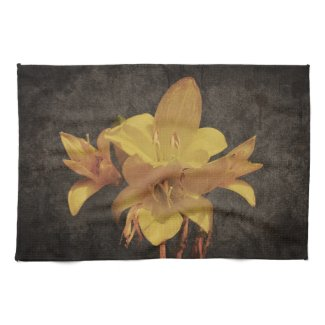 Yellow Asiatic lily on old grunged canvas backgrou Towel