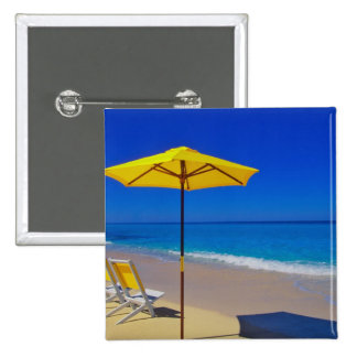 Yellow beach umbrella and chairs on pristine 2 inch square button