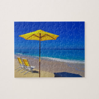 Yellow beach umbrella and chairs on pristine jigsaw puzzle