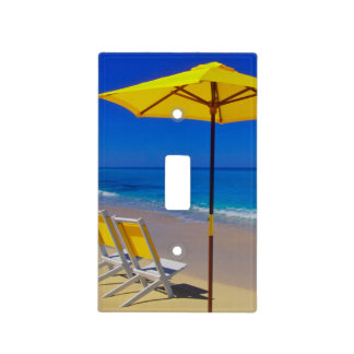 Yellow beach umbrella and chairs on pristine light switch cover