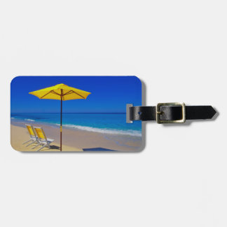 Yellow beach umbrella and chairs on pristine tag for bags