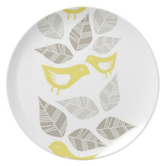 yellow birds with gray messy leaves on white dinner plate