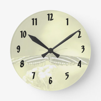 yellow black butterfly yellow fade head on wings round clock