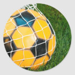 Yellow & Black Soccer Ball in Net Round Stickers