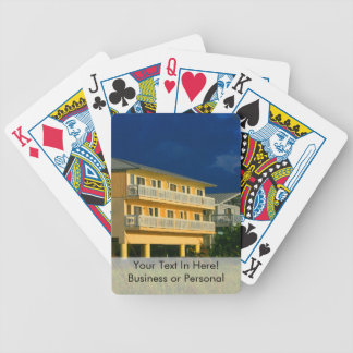 yellow building beach homes sat bicycle playing cards