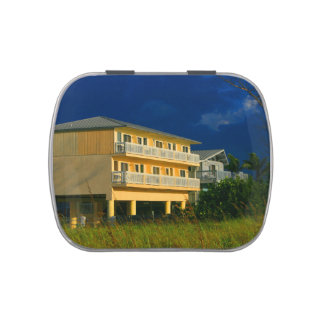 yellow building beach homes sat candy tin