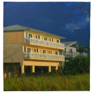 yellow building beach homes sat cloth napkin