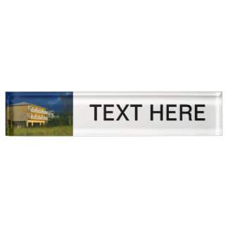 yellow building beach homes sat desk name plate