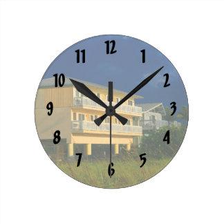 yellow building beach homes sat round wall clock