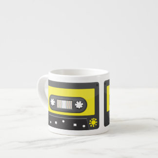 yellow cassette with rainbow tape espresso cup