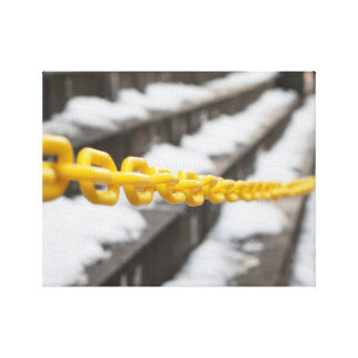 yellow chain on snowy steps canvas print
