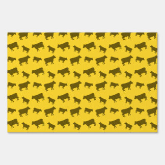 Yellow cow pattern sign