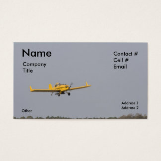 yellow crop duster tree top business card