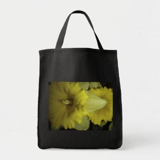 Yellow daffodils photograph on a bag. tote bag