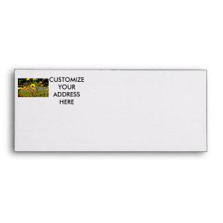 Yellow daisy ish flowers green background envelope