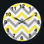 "Yellow, Dk Gray Wht Large Chevron ZigZag Pattern Large Clock<br><div class=""desc"">Yellow, Dark Gray and White Large Chevron ZigZag Pattern You can also customize this with your own images and text to create your own unique one-of-a-kind design. If you would like this pattern in other colors, just drop us an email. Please note that this is a digitally created graphic design...</div>"