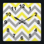 "Yellow, Dk Gray Wht Large Chevron ZigZag Pattern Square Wall Clock<br><div class=""desc"">Yellow, Dark Gray and White Large Chevron ZigZag Pattern You can also customize this with your own images and text to create your own unique one-of-a-kind design. If you would like this pattern in other colors, just drop us an email. Please note that this is a digitally created graphic design...</div>"