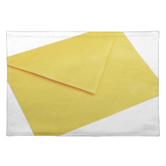 Yellow envelope isolated on white placemat