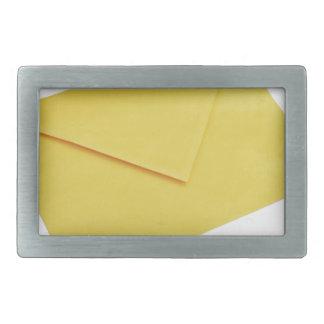 Yellow envelope isolated on white rectangular belt buckle