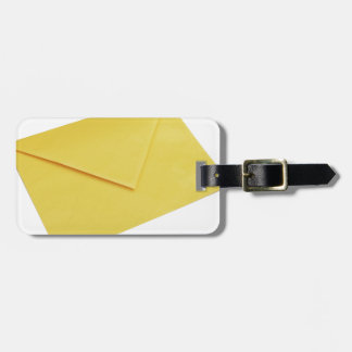 Yellow envelope isolated on white tag for luggage