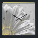 """Yellow Floral Highlights Square Clock<br><div class=""""desc"""">The cute Yellow Floral Highlights Square Clock is a bright addition to the decor of your bedroom, office, apartment or dorm room. A pretty flowery custom clock makes a unique gift idea for a flower lover, gardener or florist. This contemporary botanical clock features a digitally enhanced black and white floral...</div>"""