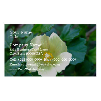 Yellow flower against dark green leaves business card
