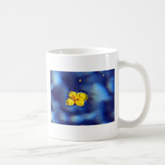 Yellow flower atop blue waters mug