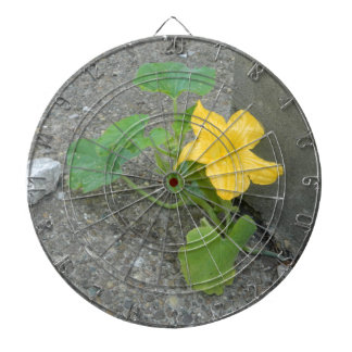 Yellow Flower Grows In Concrete Dartboard